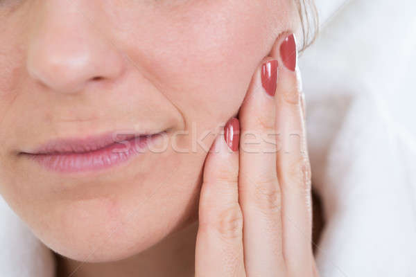Woman With A Toothache Touching Face Stock photo © AndreyPopov