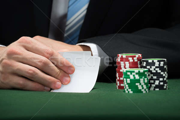 Poker Player Hand With Cards And Chips Stock photo © AndreyPopov