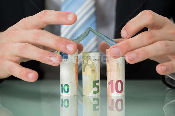 Businessperson Hand Making House Of Banknotes Stock photo © AndreyPopov