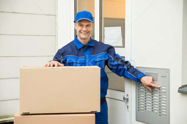 Delivery Man Using Intercom To Enter Home Stock photo © AndreyPopov