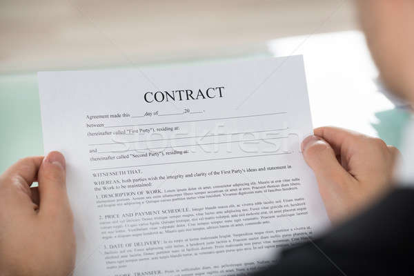 Businessman Holding Contract Form Stock photo © AndreyPopov