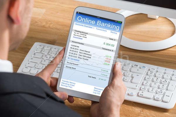 Businessperson Online Banking Using Digital Tablet Stock photo © AndreyPopov