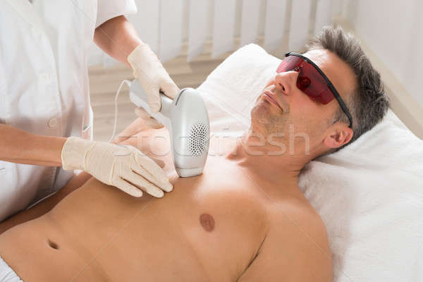 Beautician Giving Laser Epilation Treatment To Man Stock photo © AndreyPopov