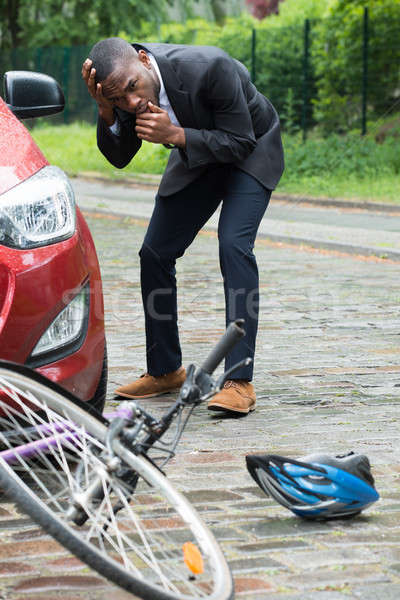 Male Driver Looking At Bicycle After Collision On Street Stock photo © AndreyPopov