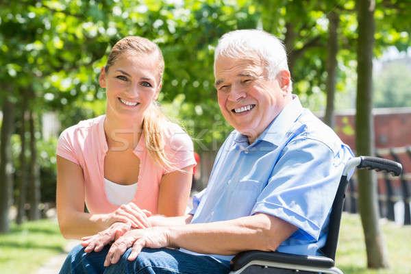 Sorridente mulher jovem inválido pai retrato cadeira de rodas Foto stock © AndreyPopov