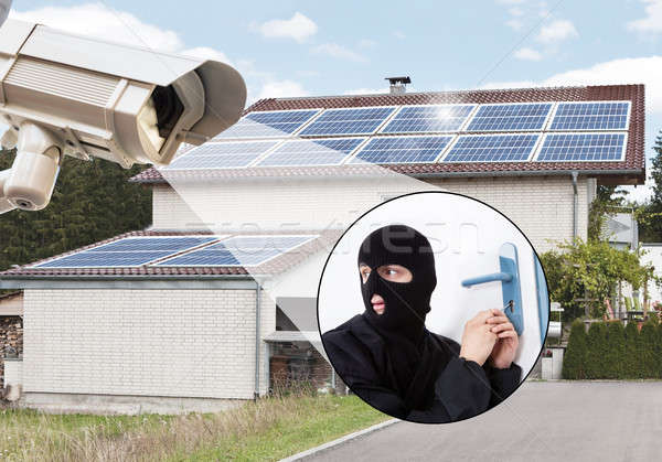 Security Camera Capturing Thief Entering House Stock photo © AndreyPopov