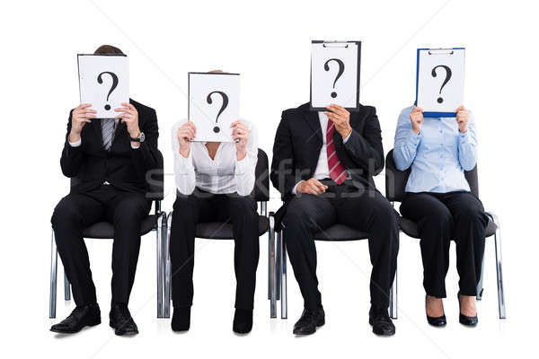 Businesspeople Holding Question Mark Sign Stock photo © AndreyPopov