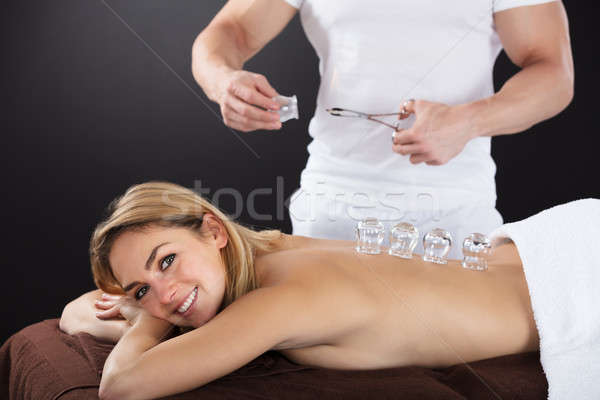 Smiling Woman Receiving Cupping Treatment On Back Stock photo © AndreyPopov