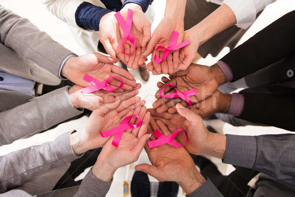 Businesspeople Showing Pink Ribbon In Their Hands Stock photo © AndreyPopov