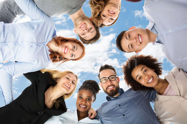 Group Of Happy College Students Forming Huddle Stock photo © AndreyPopov