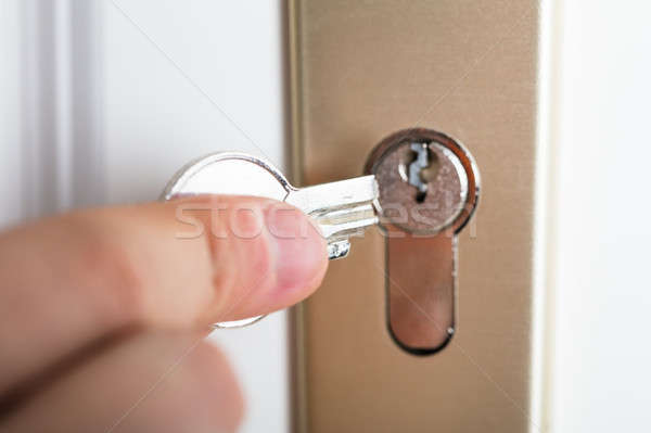 Hand Holding Broken Key Stock photo © AndreyPopov