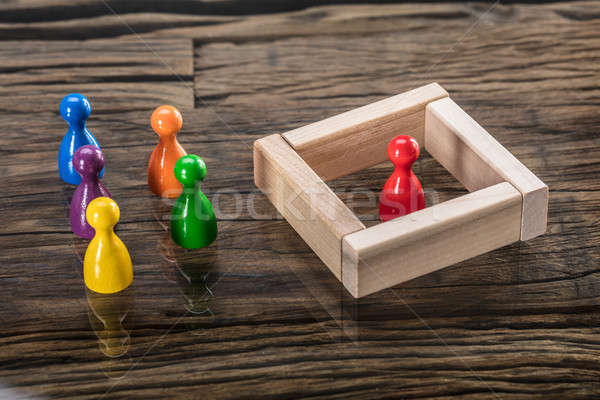 Multi Colored Figurine Pawn And Wooden Blocks On Desk Stock photo © AndreyPopov