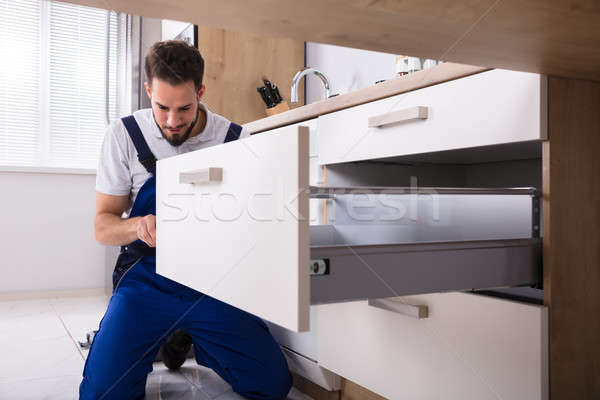 Handyman Installing Drawer Stock photo © AndreyPopov