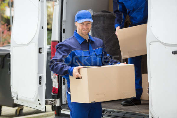 Delivery Man Carrying Cardboard Box Stock photo © AndreyPopov