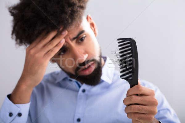 Man naar haren verlies jonge man Stockfoto © AndreyPopov