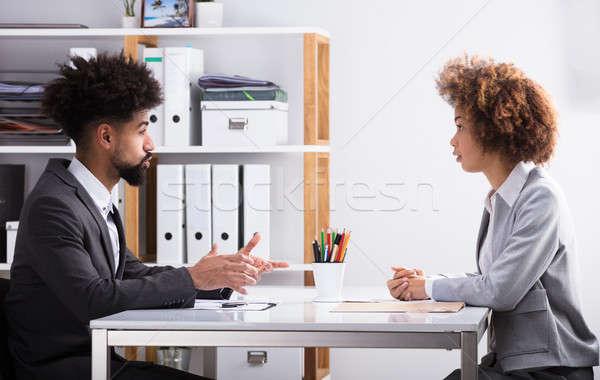 Dois conversa escritório vista lateral jovem Foto stock © AndreyPopov