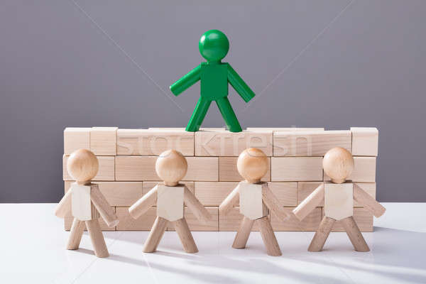 Human Figure Standing On Top Of Wooden Blocks Stock photo © AndreyPopov