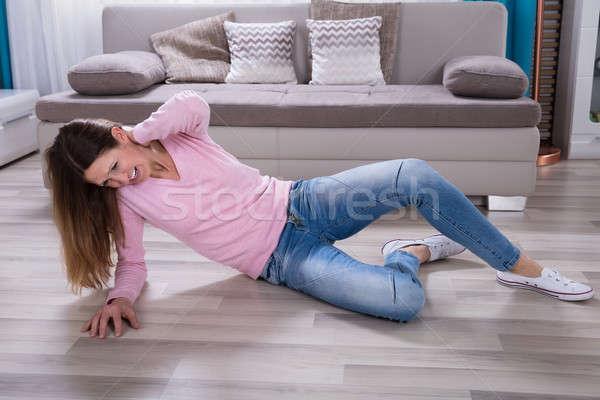 Kobieta ból szyi domu domu sofa Zdjęcia stock © AndreyPopov
