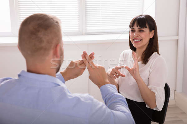 Stock photo: Man And Woman Making Sign Languages