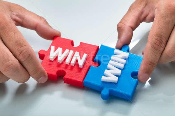 Személy kapcsolódik kettő győzelem szó puzzle Stock fotó © AndreyPopov