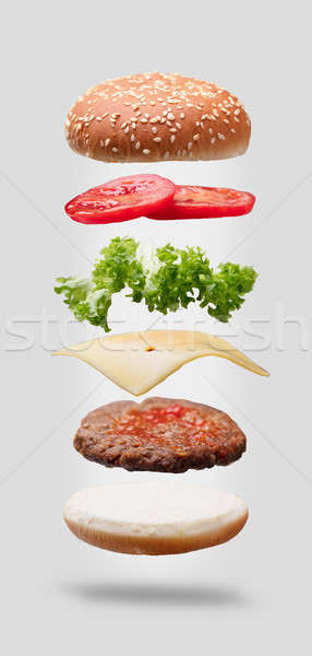 Photo Of Hamburger Ingredients On Black Background Stock photo © AndreyPopov