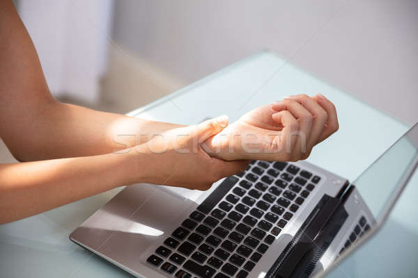 Businesswoman Holding Painful Wrist Stock photo © AndreyPopov
