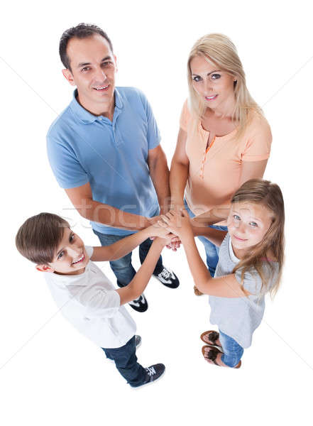 Elevated View Of Family Putting Hands Together Stock photo © AndreyPopov
