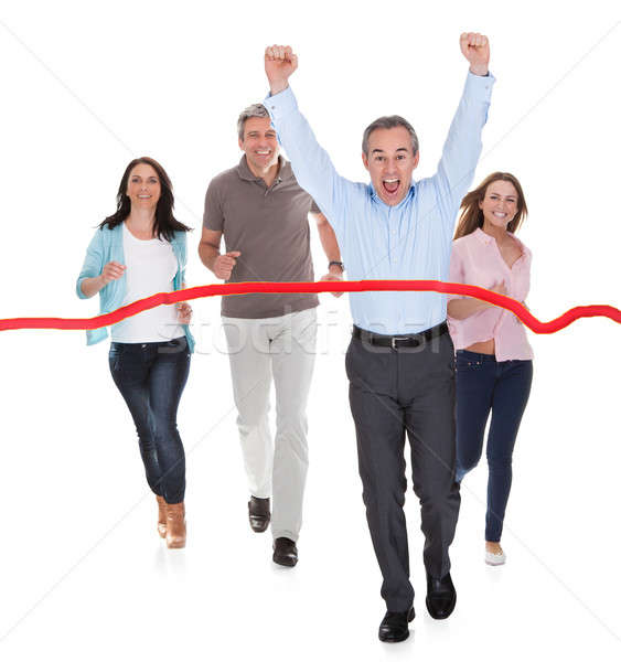 Excited Businessman Wins The Race Stock photo © AndreyPopov