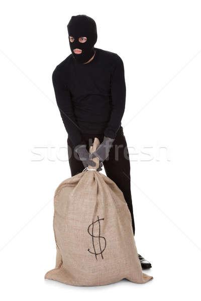 Dief groot zak geld zwarte kleding Stockfoto © AndreyPopov