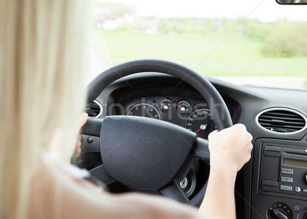 Femenino mano volante primer plano mujer Foto stock © AndreyPopov