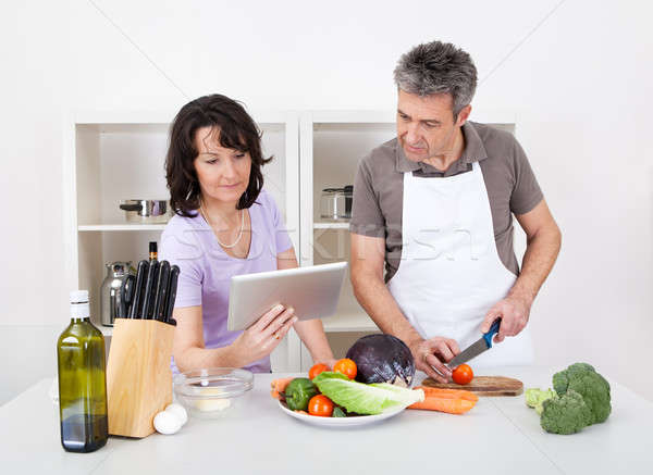 Senior couple cooking lunch at home Stock photo © AndreyPopov