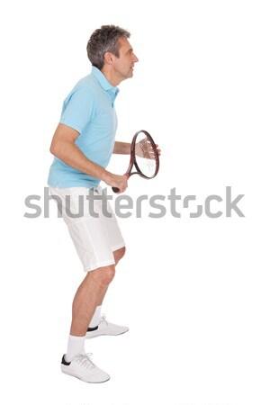 зрелый человек играет теннис изолированный белый спорт Сток-фото © AndreyPopov
