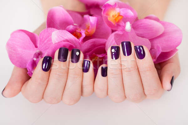 Woman with beautifully manicured nails Stock photo © AndreyPopov