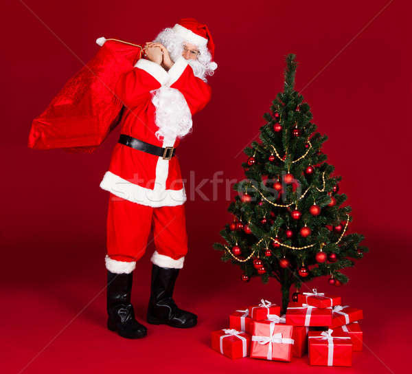 Santa carrying gifts in sack Stock photo © AndreyPopov