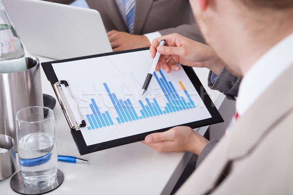 Business People Discussing On Graph At Conference Table Stock photo © AndreyPopov