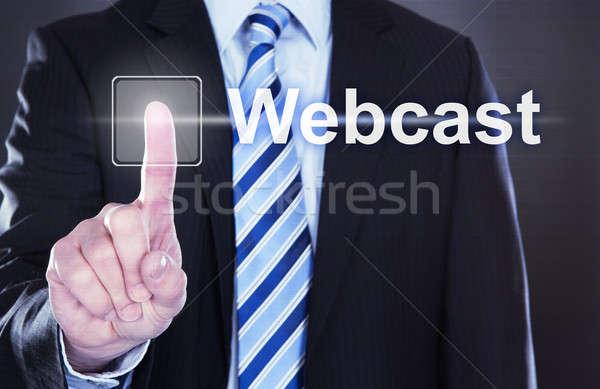 Businessman Pressing Webcast Button Stock photo © AndreyPopov