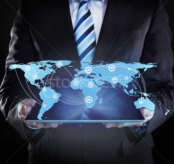 Businessman Holding Digital Tablet With Connected World Map Stock photo © AndreyPopov