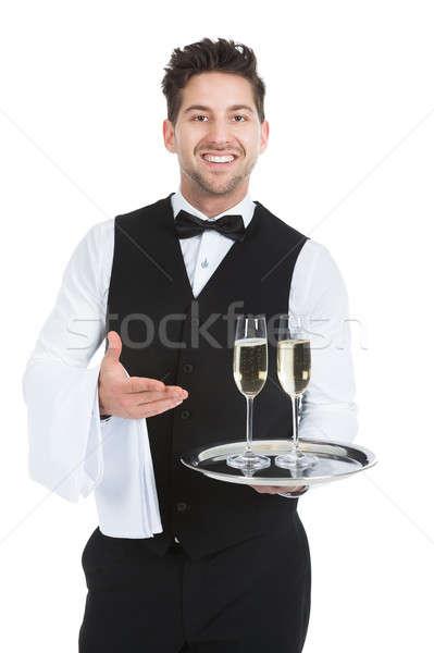 Camarero champán flautas bandeja retrato Foto stock © AndreyPopov