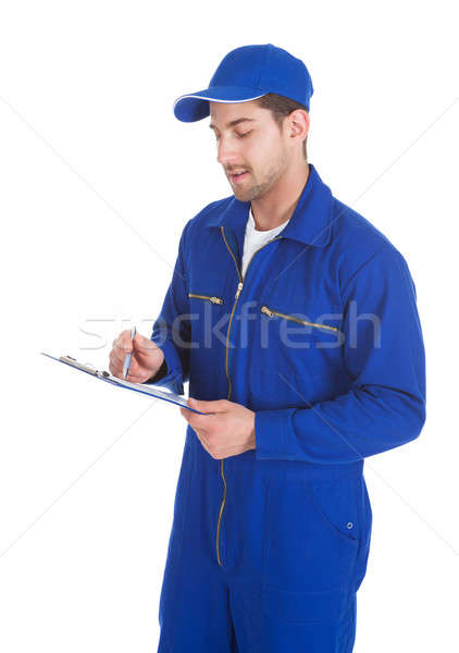 Mechanic In Overall Writing On Clipboard Stock photo © AndreyPopov