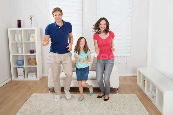 Happy Family Pretending To Run Stock photo © AndreyPopov