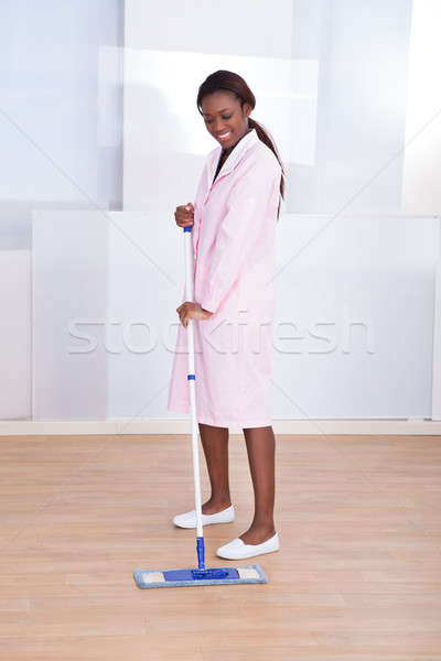 Housekeeper Mopping Floor In Hotel Stock photo © AndreyPopov