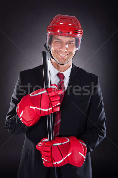 Businessman Dressed As Hockey Player Stock photo © AndreyPopov