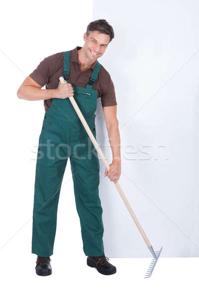 Male Gardener Working With Pitchfork Stock photo © AndreyPopov