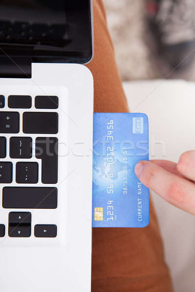 Man Inserting Credit Card In Laptop Stock photo © AndreyPopov