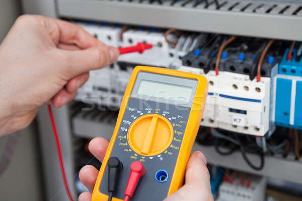 Electrician Examining Fusebox With Resistance Tester Stock photo © AndreyPopov