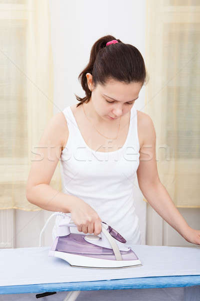 Young Woman Ironing Clothes Stock photo © AndreyPopov