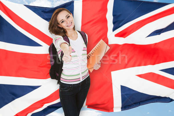 Student Gesturing Thumb Up Sign Stock photo © AndreyPopov
