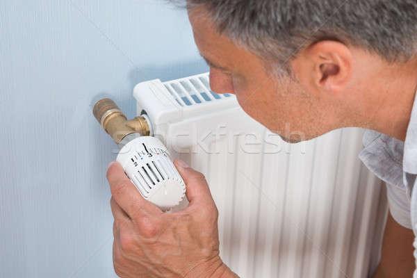 Közelkép férfi radiátor hőmérséklet energia erő Stock fotó © AndreyPopov
