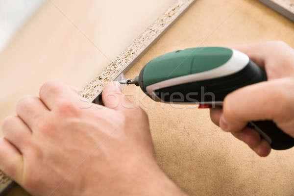 Person Drilling Furniture Stock photo © AndreyPopov