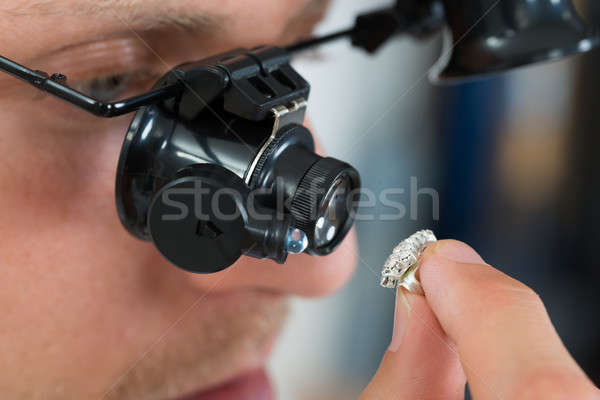 Jeweler Looking Ring With Loupe Stock photo © AndreyPopov